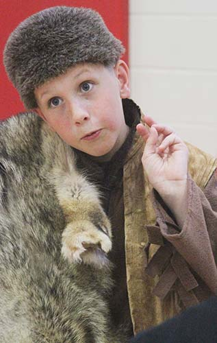 Photo by Keith Stewart Sullivan fourth grader Ben Bushue portrays Davy Crockett during the live wax museum project at Sullivan Elementary.