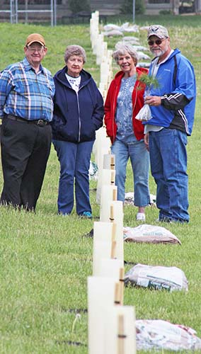 Photo by RR Best Pictured are those who volunteered to replace the treeline at Okaw Valley Middle School two weeks ago. From left to right: Roger Kirkwood, Lillian Beckett, Nannette Ramsey, and Mike Cummins.