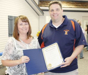 Submitted Kinney Recognized Pictured are Senator Chapin Rose with outgoing Douglas and Moultrie County Farm Bureau Manager Kara Kinney. Senator Rose attended the open house at the Douglas County Farm Bureau June 5 and presented Kinney with a certificate of Senate Recognition from the state of Illinois in recognition of her years of dedication and service as manager for the Moultrie and Douglas County Farm Bureaus.