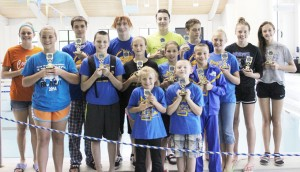 Submitted by Don Rousser Pictured are a portion of the Sullivan Blue Dolphins' trophy winners from their June 1 meet: Front row, left to right: Tabitha Clark and Kaiden Smith; Middle row: Allison Oligschaeger, Brodie Goss, Ailey Mitchell, Gabrielle Spain, Noah Spain, and Calista Clark. Back row: McKenna Kull, Dylan Sanders, Connor Russell, Charlie Goss, Addison Graham, Anna Wooters, and Natalie Drury.