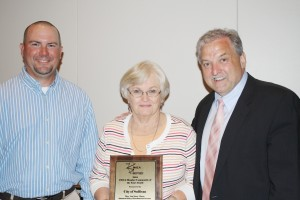 Submitted Illinois Municipal Utilities Association President & CEO Kevin Gaden (right) presents the IMUA Member Community of the Year Award to City Distribution Foreman Shannon Risley (left) and Sullivan Mayor Ann Short (center).