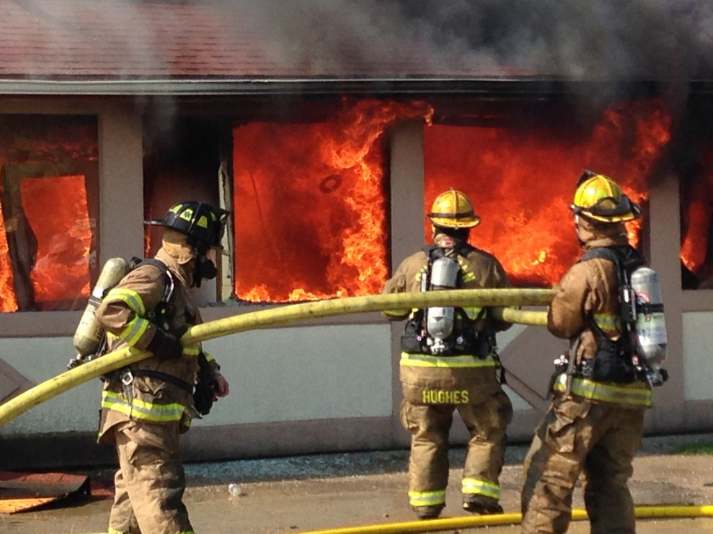 Photo by Keith Stewart Firefighters douse flames on the south side of the Red Apple restaurant in Sullivan Tuesday morning.