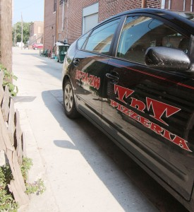 Photo by Keith Stewart A TNT Pizzeria delivery vehicle sits in the alleyway, which was the site of an incident last month when a Little Theatre staff member and a TNT delivery collided. As a result, the Sullivan City Council is considering an ordinance making the alleyway a one-way after the request by LTOTS executive director John Stephens. However, TNT owner Tim Rose doesn't believe that will prevent another such occurrence in the future.