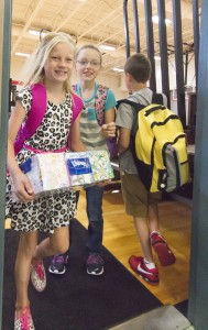 Photo by Keith Stewart First Day Back Sullivan Elementary School fourth graders Kylee Ragsdale (left) and Hannah Chance (right) exit the gym on their way to class last Thursday, marking the beginning of the school year for Sullivan.