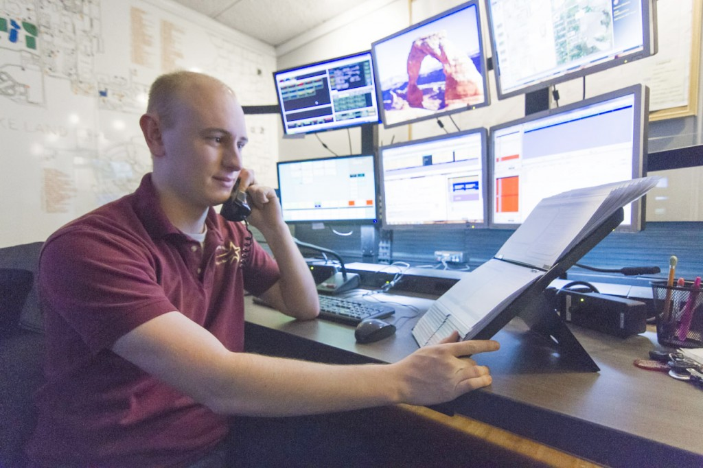 Photo by Keith Stewart A.J. Roley, a 911 dispatcher at the Coles County Emergency Communications Center, handles an emergency call last Thursday night.
