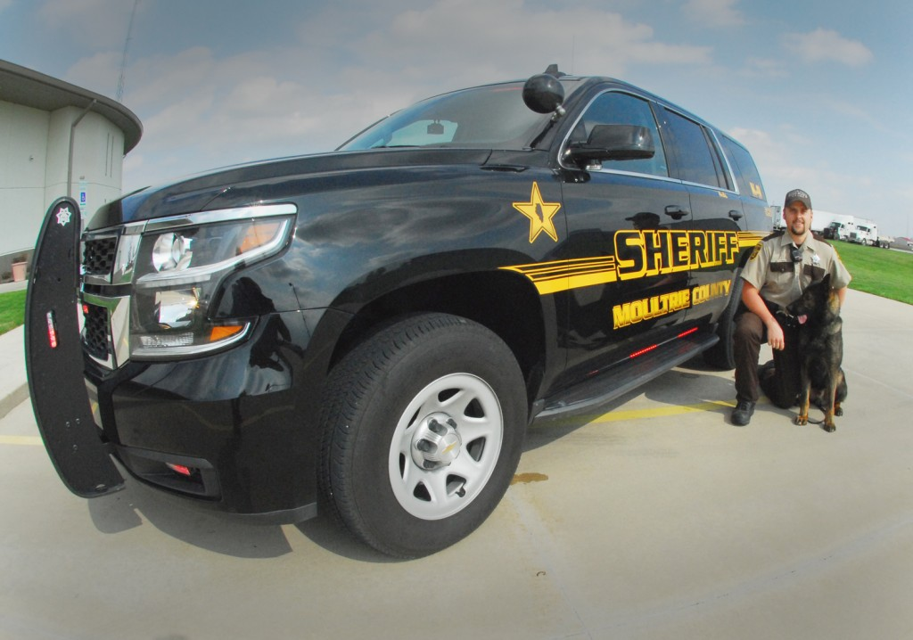 Photo by RR Best Pictured is Moultrie County deputy Caleb Smith along with the department's K-9 next to the latest vehicle addition–a 2015 Chevrolet Tahoe fully equipped and valued at over $62,000. The purchase was made possible by a recent private donation.