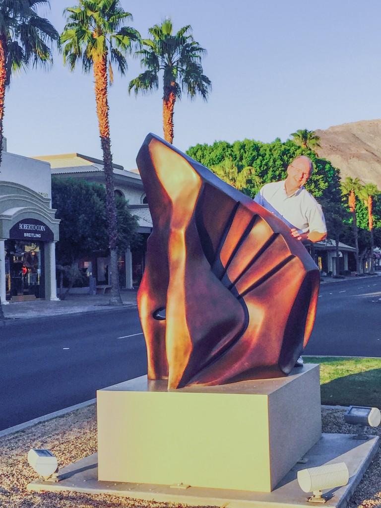 "Photo submitted Pictured is Sullivan native Patrick Blythe seen behind his  eight foot tall bronze sculpture titled, ""Harvest"" which has been installed in the median of El Paseo, between Sage and Ocotilla in Palm Desert, Calif."