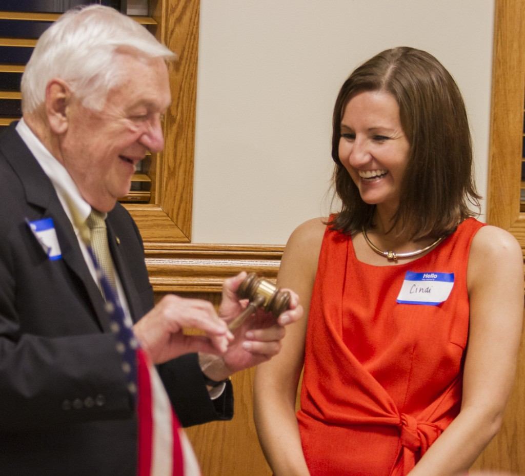 Photo by Keith Stewart Sullivan Kiwanis Club President Cindi Reed (right) is presented the club's gavel by Jim Dooley as part of the charter ceremony Monday night.