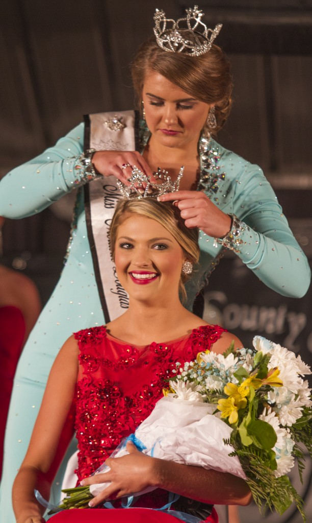 Photo by Keith Stewart Pictured is Gabrielle Uphoff of Sullivan being crowned Miss Moultrie-Douglas Tuesday night by the former Miss Mo-Do Maria Meyer.