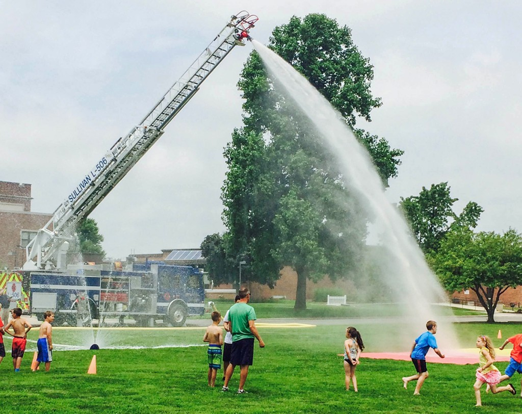 Photo submitted by Melissa Haegen Children enjoy the waterworks provided by the Sullivan Fire Department last Wednesday as part of the popular park recreation program at Wyman.