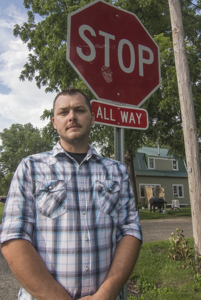Photo by Keith Stewart Sullivan resident Tyler Wagey stands in front of a newly installed 4-way stop-sign at the intersection of Washington and Blackwood after he went to the city council with concerns about vehicles speeding throughout the neighborhood.