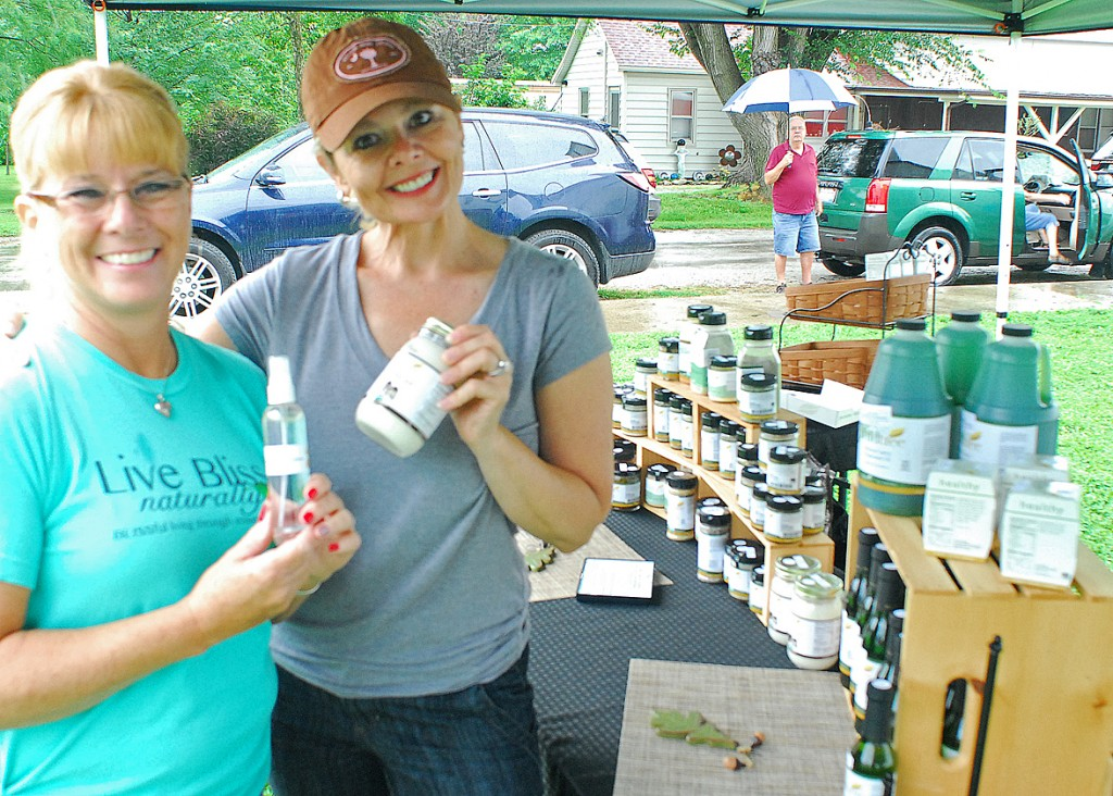 Photo by RR Best Pictured are Lisa Jackson (left) and Bonnie Scott (right), who are both vendor's at the farmer's market. Jackson sells Young Living essential oils while Scott offers kitchen products by the company Wildtree.