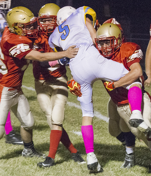 Photo by Keith Stewart Defense came alive as Knights gather for the stop during Friday's game in Clinton.