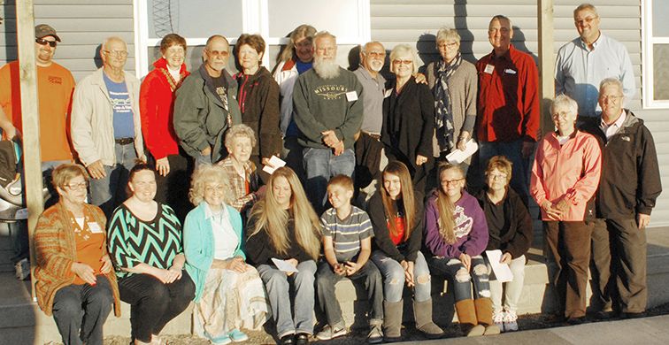 Photo by Mike Brothers Hope Street Habitat for Humanity home in Sullivan is number 26 and was turned over to owner Nikki Bassett on October 16. Participating in the ceremony were: Pastor Dan Fultz, Moultrie County Habitat Board members, Habitat for Humanity Care-A-Vanners; Bassett  and children Jordan, Jade and Maddux; family and friends.
