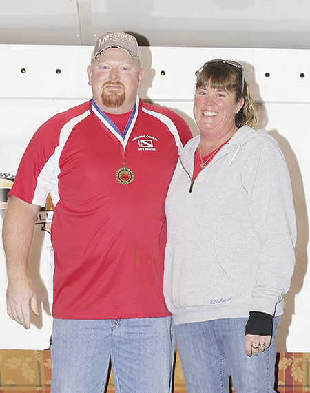 Photos courtesty Heather Casteel Grand Champion- Moultrie County Dive Team, head cook Roger Farley with Amanda Farley.