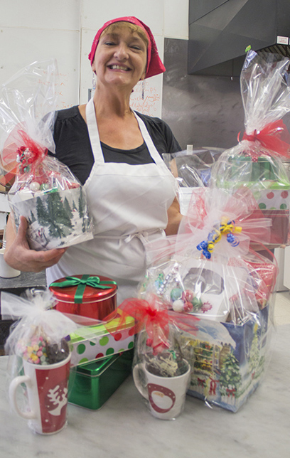Photo by Keith Stewart Pictured is Devon Flesor Story, part-owner of Flesor's Candy Kitchen, which is located in Tuscola. She along with her staff will be selling a variety of candies, some new, in Sullivan come November 21 as a fundraiser for the Moultrie County Food Pantry.