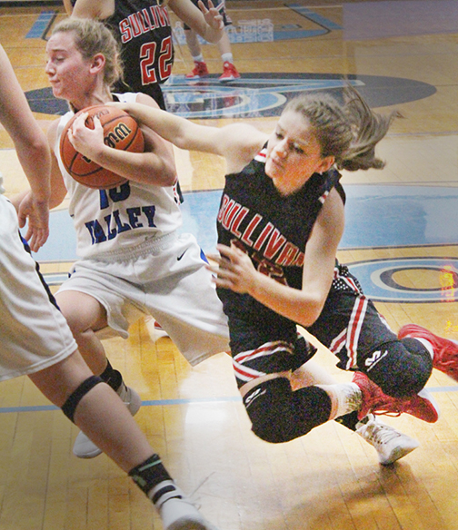 Photo by RR Best Ball possession was important in the Okaw Valley - Sullivan match as Lady Timberwolf Brianna Creviston and Lady Redskin Haley Rose fight for the ball last Thursday.