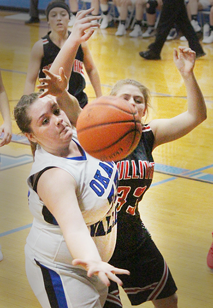 Photo by RR Best At left: During a close game in Bethany between Okaw Valley's Lady Timberwolves and Sullivan's Lady Redskins Danielle Lochbaum of Okaw Valley and Sullivan's Ally Elzy battle for a rebound.