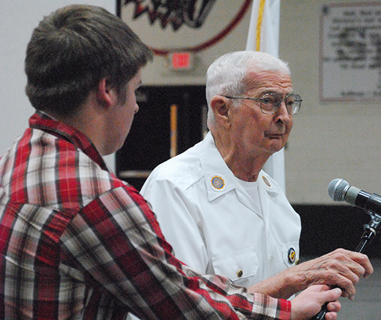 Photo by Mike Brothers Careers student Brad Kay introduces WWII veteran Myron Haney.
