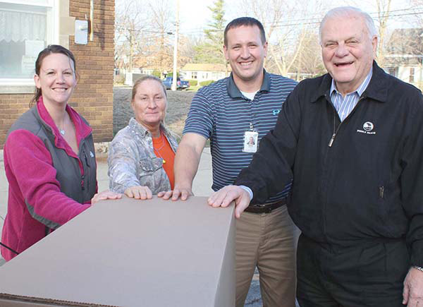 Photo by Mike Brothers Final Food Pantry delivery was made by Hydro Gear to CEFS- Pictured from L to R:  Kristy Dawson, CEFS; Kelly Brown, HG Material Handler; Chris Zerrusen, HG Safety Team Leader; Ron Harshman, Chairman of the Board of all Agri Fab Holdings.