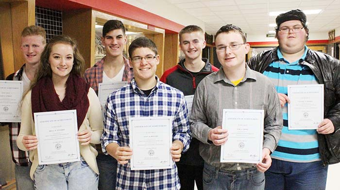 Photo by Mike Brothers Seven Scholars for Sullivan-Sullivan High School students selected as Illinois State Scholars are: (Front from left) Emily Stutzman, Ross Metzger, Ryan Baker; (back) Blake Stewart, Zane Uphoff, Adam White and Michael Hubbert.