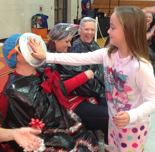 Photo Courtesy Sullivan Schools Good Behavior Brings Big Fun Good behavior received a big reward for students at Sullivan Elementary School last week. Students got to have some good fun by throwing pies into the faces of teachers and administrators December 18. Above Ruby Haegen hits first grade teacher Eudora Drollinger square in the face with a cream pie.
