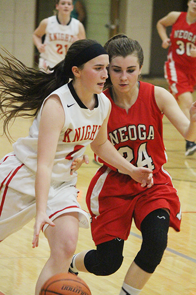 Photo by Darian Hays Lady Knight Mycaella Miller maneuvers around Neoga Indian Banning in the 82-74 win over Neoga last week. Miller finished the night with 11 points.