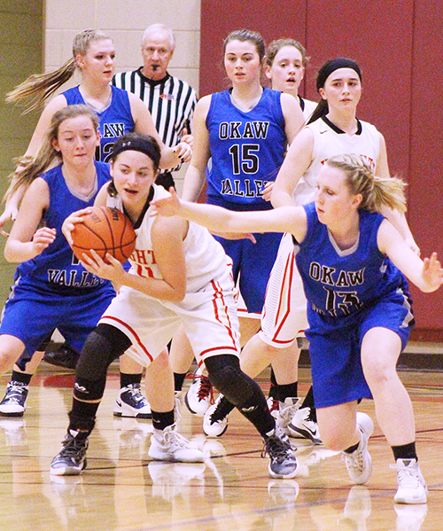 Photo by RR Best ALAH Knight Janette Comstock protects the ball as Okaw Valley Timberwolves (from left) Chloe Weybright, Devan Nave, Natalie Jeffers and Brianna Creviston close in.