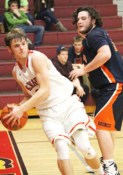 Photo by Darian Hays Marcus Vanausdoll works toward two of 15 points scored against the Cerro Gordo Broncos January 22.