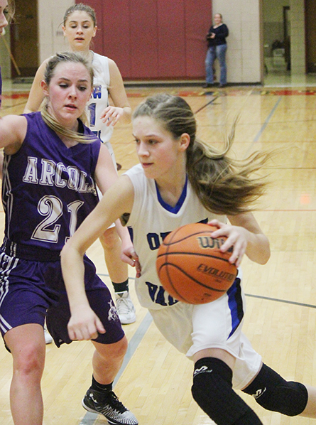 Photo by Darian Hays Paige Robinson drives against Purple Rider Rylee Fishel for two of her game leading 17 points, helping the Knights to a 42-30 wind over Arcola.