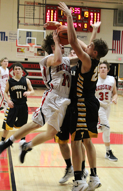 Photo by Mike Brothers Sullivan's Kaleb Shumard drives hard to the basket in the January 8 home game against the Tuscola Warriors on the Redskin home court.
