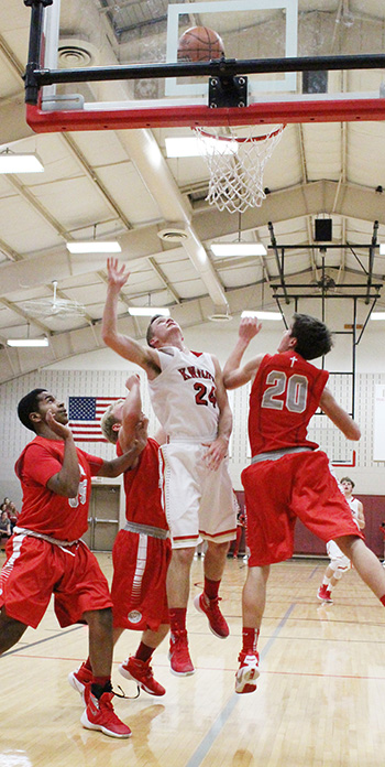 Knight Jakob Brewer leaves three Decatur LSA Lions behind going up for two of his 17 points in the ALAH win February 5.