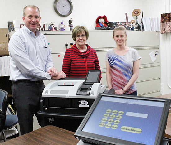 Photo Submitted New Voting Equipment: Liberty Systems LLC partner Ken Gibson, County Clerk Georgia England and Election Deputy Jamie Helton prepared the system for operation last week.