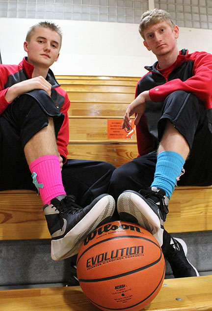 Photo by Mike Brothers Adam White and River Edwards were joined by the Sullivan Redskins basketball team wearing pink and teal socks with ribbons to honor those fighting breast and cervical cancer.