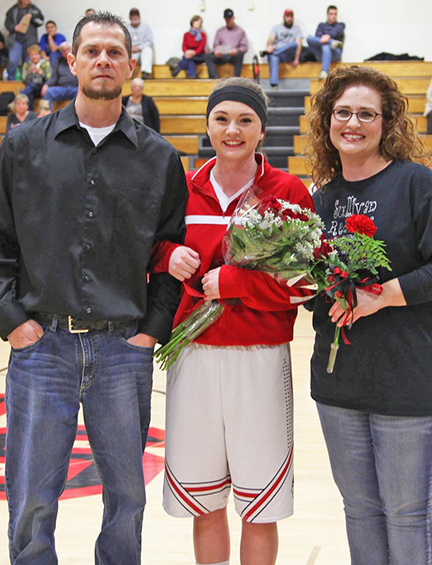 Photo by Lisa Dickens Senior Night in Sullivan honored senior Alyssa Marshall, whose parents Mike and Venessa were present for the celebration.