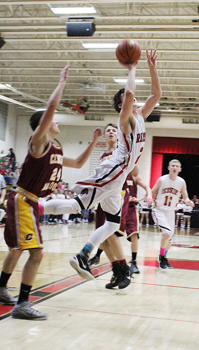 Photo by ghgh Redskin Ty Molzen is up and inside for a score as River Edwards eyes the potential defensive setup in the Feb 19 win over Clinton.