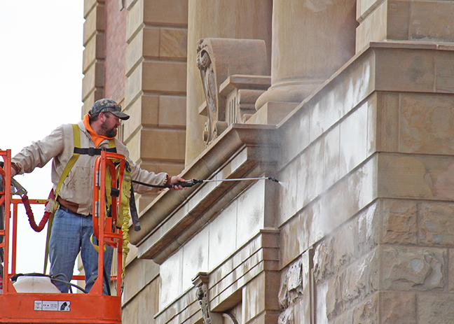 Photo by RR Best Final touches Final touches are being put on the Moultrie County Courthouse restoration project this week. Masons Masonry Restoration of Brownstown was awarded the $203,755 bid to repair stone and tuckpointing on the 112 year old structure in August 2015. Above a Mason employee is placing the final sealer on repairs to complete the project.