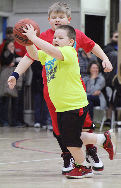 Photo by RR Best Mighty Mites Basketball Mighty Mites basketball player Aiden Burgess (above) looks for someone to pass the ball to during Sullivan action last weekend. The introductory  program for 5-8 year olds teaches basic skills, team work and good sportsmanship.