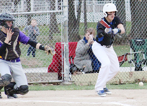 Photo by Mike Brothers Timberwolves Taylor Coleman lays down a sacrifice bunt, advancing runners to second and third base during Okaw Valley High School baseball's win over St. Elmo March 23.