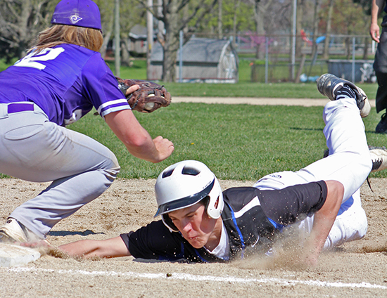 Photo by RR Best Timberwolves' Austin Hill's determination gets him to the bag just as the throw arrives in Okaw Valley's win over Shelbyville.