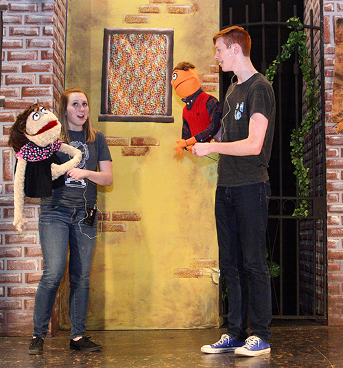 """Photo Submitted Brianna Creviston (Kate Monster) and Nick Tipsword (Princeton) rehearse a scene for Okaw Valley High School's April 22 & 23 production of """"AVENUE Q: School Edition."""""""