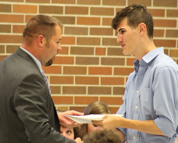 Photo by Mike Brothers Sullivan athletic director Ryan Aikman presents Blake Stewart with the L.J. Hollonbeck Memorial Track Scholarship.