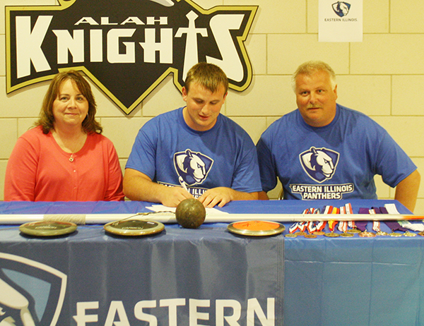 Photo furnished Yeakley Signs with EIU ALAH track stand out Colton Yeakley signed his letter of intent to participate in Eastern Illinois University track and field. At the signing on May 11 at the high school gym were Colton's mother Heidi and father Steve. Colton displayed shot put, javelin and discus on the signing table.