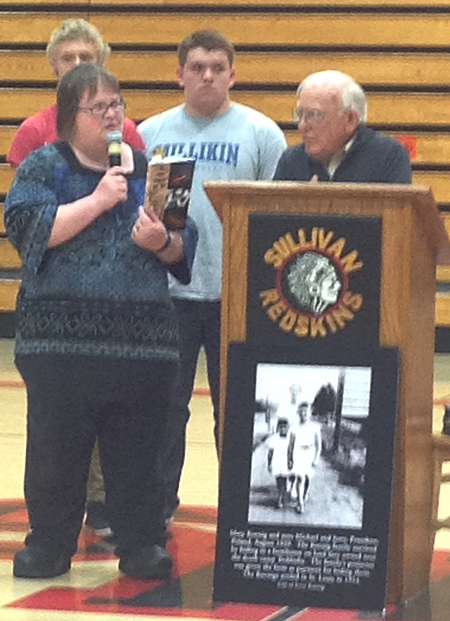 Photo courtesy Jessica Voyles Sullivan High School English teacher Rebecca Lawson left introduces Holocaust survivor Jerry Koenig, who gave his account of Poland under the  Nazis during World War II.