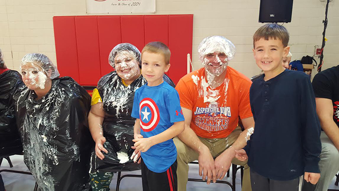 "Photo  furnished Pie in the Face was done for Box Top Collection at Sullivan Elementary School.  The students are Rhyder Pierce on the left and Liam Donovan on the right.  The teachers are Melissa Haegen on the left, Micah Heddins in the middle, and Kurt Friese on the right.  Students got to play the ""Pie in the Face"" game as a reward for collecting box tops in December."