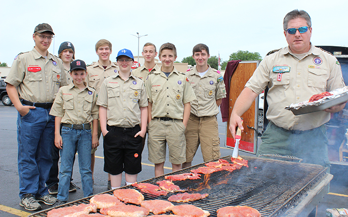 Photo by Mike Brothers Boy Scout Troop 39 Cook Out Sullivan townwide rummage sale shoppers had a chance to stop by the Sullivan IGA parking lot on June 3 and 4. Boy Scout troop 39 was offering delicious steak, pork chop and brat sandwiches giving busy shoppers a convenient lunch break. Troop 39 pictured preparing for lunch are back from left-Lake Atchison, Matthew Ellinger, Alex Menke, Khayman Van Loon, Seth Rice; front Beau Fleming, Seth Weaver and Laytin Pratt with Scoutmaster Jeff White manning the grille.