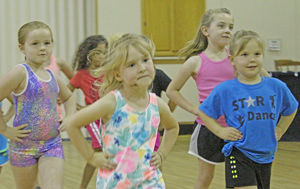 Photo by Mike Brothers Studio for Young Dancers Dancers with Miss Melissa's new studio are meeting at the First United Methodist Church in Sullivan until the permanent location downtown is completed. Above (from left) Emily Tilton, Chloe Jensen and Ava and Layla Corley go through their routine. See Ariana Cherry's story on page 5.