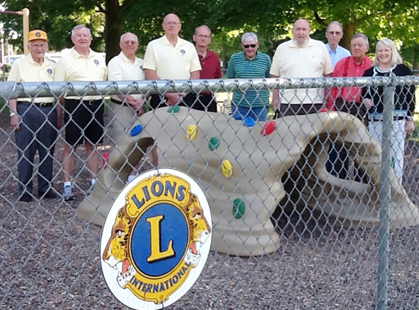 Photo furnished Lions Donate Discovery Cave Sullivan Lions Club recently donated the Discovery Cave in the preschool area in Wyman Park. Members pictured are John Ruscin, Dave Walker, Dick Martin, Bob White, Dave Reed, Jess Barker, Ed Taylor, Roger Tice, Bob Elder, and Verna Tice.