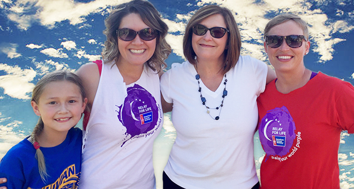 Photo furnished Relay's 20th Anniversary Relay for Life participants Emily Crosier, Jamie Crosier, Diane Waggoner and Jessi Jess take a moment during the 20th anniversary event held June 11 at Wyman Park.