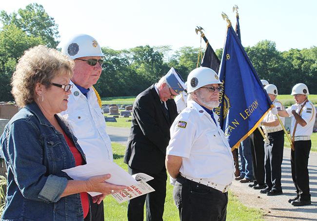 Photo by Mike Brothers Greenhill Cemetery Memorial Day program speaker Rita Florey expressed gratitude to those who have served. Post #68 Commander Bob Sims, Charles Bragg and the Honor Guard are in the background.